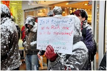 http://www.urban75.org/blog/brixton-topshop-and-vodafone-protests-brave-the-blizzards/